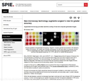 "Screenshot of the press release ""New microscopy technology augments surgeon's view for greater accuracy"" on the website SPIE.org."